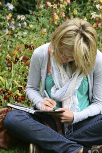 Woman writing for Yoga of Writing Brochure